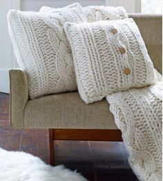 Uggs pillows (It's just a picture, but it gives inspiration.)  Get some old sweaters and make pillow covers.