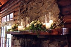 The ceremony room at Midlane has a fireplace with a mantle. This is perfect decor for it minus the pinecones.