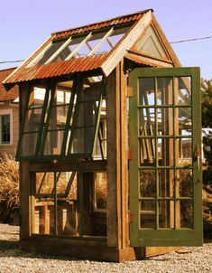 Reclaimed windows and wood greenhouse