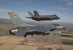 During 2014, the long-delayed F-35 next-generation fighter was moved to its new home at Luke Air Force Base, in Arizona. Here is one F-35 being escorted by an F-16.