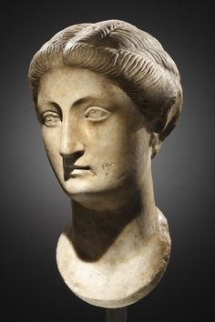A PRIVATE PORTRAIT OF A WOMAN     H. 33 cm. Marble  Roman, 2nd quarter of 2nd cent. A.D.