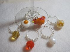 ***Please do not pin this just to use as a pattern. Please respect my copyright and work.*** Chicken and egg wine glass charm set. Mug charms. by ArtsParadis, $15.00 #handmade #wine #charms #chicken #egg #brunch #mimosa
