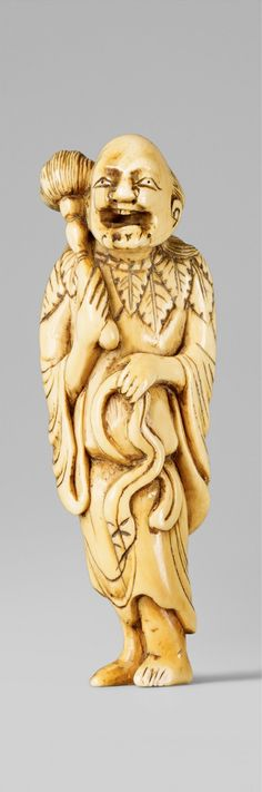 An ivory netsuke of a laughing sennin with a flywhisk. Late 18th century  Standing with a short curly beard, holding a large flywhisk and lifting his belt.  Height 8.2 cm