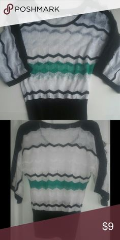 XOXO Sweater Excellent used condition sweater with no stains, tears, or snags. Material: rayon, viscose, lurex, polyester. XOXO Sweaters