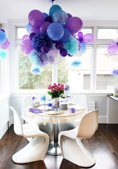 I LOVE this color theme and they way they used pom poms with the balloons !