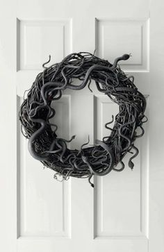 Grandson and I did this and it's fantastic fun and easy. A cool and spooky Halloween wreath - slithering snakes from Martha Stewart