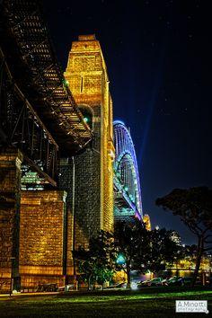 Light dances across the Sydney Harbour Bridge, one of Australia's iconic landmarks and a popular tourist destination.