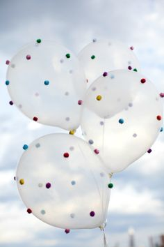 Cool attention getting balloons for a show booth. Party time balloons- glue mini pom poms on the balloons- color coordinate to your booth.