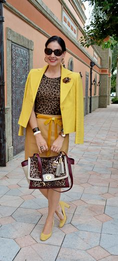 Susana Fernandez | A Key to the Armoire / leopard print / yellow /tan leather skirt / Ralph Lauren / Coach / ocelot print / animal print / antique ivory cuffs / Lea Stein Paris brooch / Jord Watch / wood watch / Saks Fifth Avenue Black / leather pencil skirt / ribbon belt / J Crew / Ann Taylor / yellow pumps / work attire / office attire