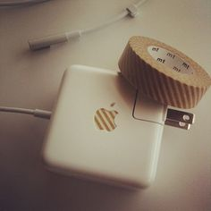 decorating with washi tape    Everyone in my office has the same Apple products so I made my charger unique with some washi tape.