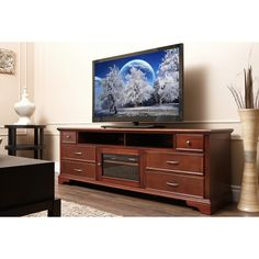 Complete your home decor with this beautiful Montgomery entertainment console. Featuring a gorgeous walnut finish, six drawers and two center shelves for extra storage, this sleek home entertainment center is sturdy enough for all types of televisions.