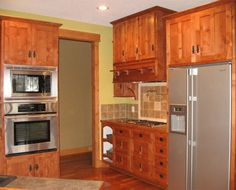 Kitchen Cabinets Mission Style cabinet fronts, molding at ceiling, apron sink. california mission