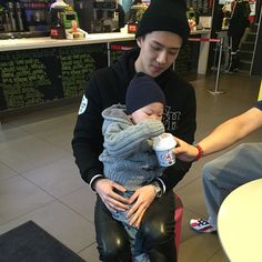 Sehun with a baby