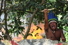 A native man gestures as he protests against eviction from the former Indigenous Museum -- aka Aldea Maracana -- next to the Maracana stadium in Rio de Janeiro, Brazil, on March 22, 2013. Indigenous people have been occupying the place since 2006, which is due to be pulled down to construct a parking lot for the upcoming Brazil 2014 FIFA World Cup. (Vanderlei Almeida/AFP/Getty Images)