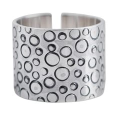 NOVICA .925 Sterling Silver Handcrafted Wide Band Ring, 'Circles'. An original NOVICA fair trade product in association with National Geographic. Includes an official NOVICA Story Card certifying quality & authenticity. NOVICA works with Carolina and Jorge to craft this item. Includes an original NOVICA jewelry pouch to keep for yourself or give as a gift. A keepsake treasure designed to be loved for years to come.