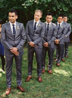 Handsome groomsmen in dapper charcoal gray suits