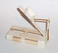 Teeny tiny catapult for our castle! Of course, the boys will just want to launch birds from it.
