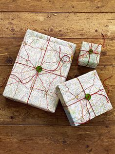 Freebie road maps and atlas pages serve as great graphic gift wrap. Learn how to make your own! http://www.countryliving.com/crafts/projects/holiday-craft-projects-1209#slide-4