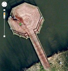 There are these internet rumors going around that Google Maps Satellite view captured a man dragging a body into a lake in broad daylight.    You can see the satellite imagery yourself on Google Maps at 52.376552...