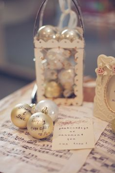 Molly -  Here's an idea - have a picture of your engagement with Santa in a frame on the guestbook table --- and then have each guest sign a small ornament ball that will go on your future Christmas tree or perhaps you could make a wreath of all the signed ornaments.