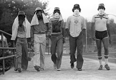 Young men don masks to keep out ash from Mt. St. Helens's eruption May 18 1980
