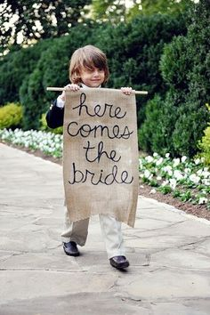 """I wouldn't necessarily choose burlap, but I think it would be ADORABLE to have your ring bearer carrying a sign that says, """"Just wait 'til you see her!"""" <3"""