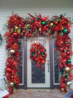 Large Christmas door surround... I would do away with the door wreath it takes away from this beautiful garland