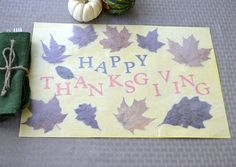 Pressed Leaf DIY Thanksgiving Placemat | 14 DIY Placemats for Thanksgiving, check it out at http://diyready.com/homemade-thanksgiving-decorations-14-diy-placemat-ideas
