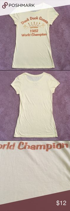 Duck Duck Goose World Champion T-Shirt Lightweight, soft Duck Duck Goose World Champ tee. Great quality cotton. Worn once, extremely subtle discoloration mark (see photo 3). Otherwise, like new! Little Bay Tops Tees - Short Sleeve