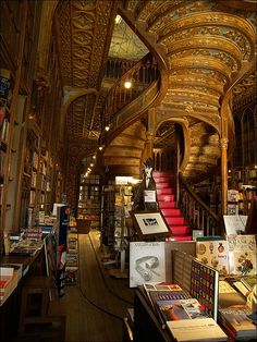 book shop in Portugal somewhere. beautiful staircase.