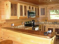 Handcrafted rustic cabinets, featured are hickory cabinets that are ...