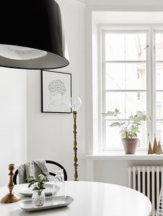 love the sparse, uncluttered style of this minimal dining or breakfast room DIY (and totally digging the artwork) from myunfinishedhome.com / Black and White Home / Illustration / Pen and Ink Artwork / Modern Home