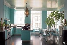 Decorator Thomas Britt outfitted this New York City kitchen with corresponding aquamarine walls and furnishings.