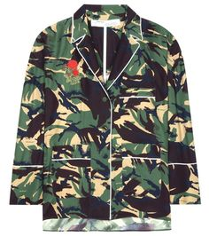 """OFF-WHITE - Camouflage printed silk blouse - Virgil Abloh's finger is constantly on the pulse of street style, and this camouflage printed blouse is no exception. The design takes cues from loose-fitting pyjama cuts, reinforced through the use of high-contrast white piping. """"WOMAN"""" is printed in white on the back for a dose of rebellious cool. - @ www.mytheresa.com"""