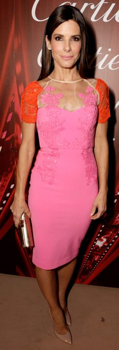 With Sandra Bullock as inspiration, let's all pledge to wear more hot pink and hot orange TOGETHER