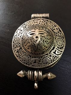 Tibetan silver large vintage silver prayer box pendant. Size: 7 X 5.5 Artisan handmade vintage Tibetan silver large prayer box. Would be stunning on a long necklace with a black dress or top. Gorgeous, solid and an eye catching design. A traditional amulet believed to bring good energy to the wearer.