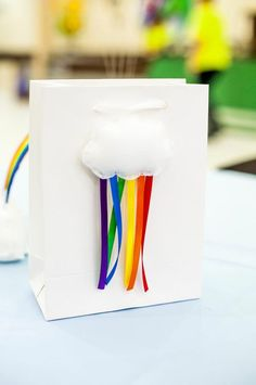 Rainbow Birthday Party: puffy cloud + ribbon favor bag decor