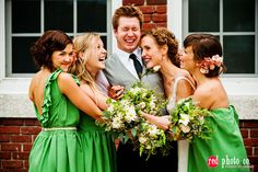 A bride with her bridesmaids and her bridesman.