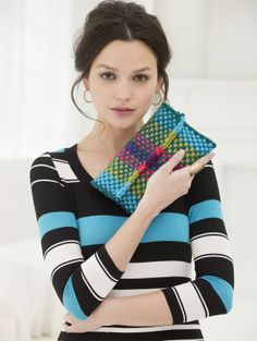 This is not a book cover. It's a woven clutch. But I think it would make a beautiful book cover.
