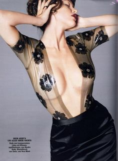 Pazde la Huerta wears black latex Atsuko Kudo semi-transparent cloud grey latex Jessica Body with 2D Applique Flowers for Glamor Magazine.