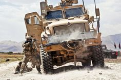 Army photo by Sgt. Michael J. MacLeod: A U.S. Army paratrooper with the 82nd Airborne Division's 1st Brigade Combat Team fires his M4 carbine at insurgents from behind an MRAP -- Mine Resistant Ambush Protected vehicle -- during a firefight in Ghazni Province.
