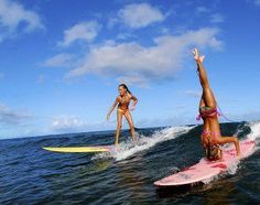 Yoga fun for surfers. / HA! Yeah right, I'd be lucky to even stand up on a surf board!