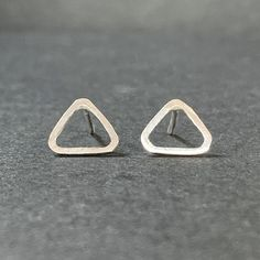 Cassie brought her sister and mum along to a Silver Earring Workshop for their birthdays. She made these minimal triangle stud earrings that sit neatly on the earlobe. Love these.