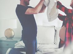 Natural light - pregnancy photoshoot Couple beauty shot - pillow fight !!  Love it 💜  facebook.com/luluavenuephotographie  www.luluavenuephotographie.com