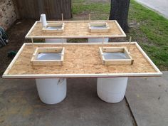 Why didn't we think of this years ago!Table tops built for crawfish. Each table has two holes cut for throwing your trash away. Tops held up by 2 55 gallon drums. Makes clean up easy! Crawfish Party, Seafood Boil Party, Crawfish Season, Seafood Broil, Crab Feast, Low Country Boil, Outdoor Projects, Outdoor Ideas, Outdoor Spaces