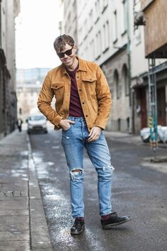 "Off-duty denim. Andreas Swijk rocks his 501 Skinny Jeans in the ""Old Hangouts"" wash with a camel-colored Trucker Jacket and a burgandy tee underneath during Stockholm's Fashion Week. Photo: Emma Svensson"
