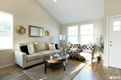 Additional Kraft Home living room staging & home remodel. Room consists mainly of neutral colors, with mixed home decor colors of browns, blacks, whites, and gold. The lighting adds a certain level of extra warmth. #veronohomes #interiordesign #homedecor #house #realestate http://www.verono.com/kraft/