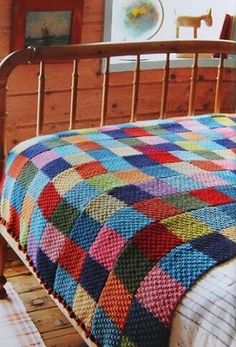 """Great idea: """"For this blanket, Jane used double moss stitch and knit five """"scarves"""" that were then sewn into one big blanket."""" Find a scarf pattern (or two) and then make scarves in to a blanket. More interesting than knitting a whole blanket! Crochet Quilt, Knit Or Crochet, Crochet Scarves, Blanket Crochet, Patchwork Blanket, Knit Squares Blanket, Easy Knit Blanket, Patchwork Ideas, Crochet Bedspread"""