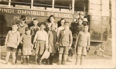 """"""" School outing Rawalpindi """"- Writing on the bus: Rawalpindi Omnibus Service Public. Students lined up for a photo."""