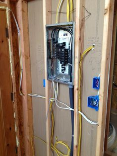 """Main electrical panel that will be fed by the solar panels, inverter and battery system. """"Looks like a traditional panel but it's 100% powered by the sun. The 21st century tiny house has a lot of circuits."""" Adam and Karen's Tiny House in Equinunk PA - Step 4: The Finishes"""